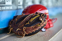 Clearwater Threshers catchers mask, helmet and Mizuno catchers glove in the dugout before a game against the Dunedin Blue Jays on April 8, 2016 at Bright House Field in Clearwater, Florida.  Dunedin defeated Clearwater 8-3.  (Mike Janes/Four Seam Images)