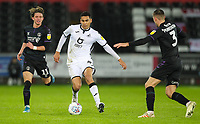 2nd January 2020; Liberty Stadium, Swansea, Glamorgan, Wales; English Football League Championship, Swansea City versus Charlton Athletic; Ben Cabango of Swansea City brings the ball forward against Purrington of Charlton - Strictly Editorial Use Only. No use with unauthorized audio, video, data, fixture lists, club/league logos or 'live' services. Online in-match use limited to 120 images, no video emulation. No use in betting, games or single club/league/player publications