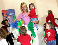 Sports agent Molly Fletcher plays with her daughters at The Music Class on Wednesday, March 22, 2006. Fletcher must juggle a busy family life with her more than full-time job representing several top sports personalities.<br />