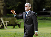 Washington, DC - October 24, 2008 -- United States President George W. Bush walks toward Marine One on the South Lawn of the White House in Washington on Friday, October 24, 2008. President Bush is traveling to the National Security Agency (NSA) in Fort Meade, Maryland for a briefing.  <br /> Credit: Alexis C. Glenn / Pool via CNP