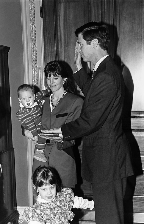 Rep. George Allen, R-Va. mock swear in Tuesday with his wife, Susan, and sons Forrest (7 months) and Tyer (3), after being sworn in as newest House Member. November 12, 1991 (Photo by Maureen Keating/CQ Roll Call)