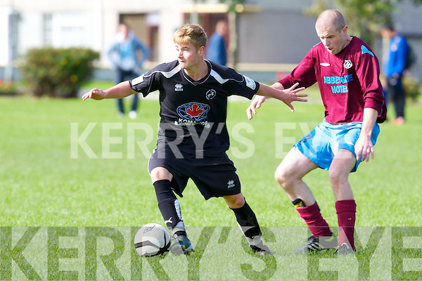 Tralee Dynamos Aaron Houlihan holds off Spa Road FC's Kevin Cunningham the Munster Junior Cup at Balloonagh, Tralee on Sunday.