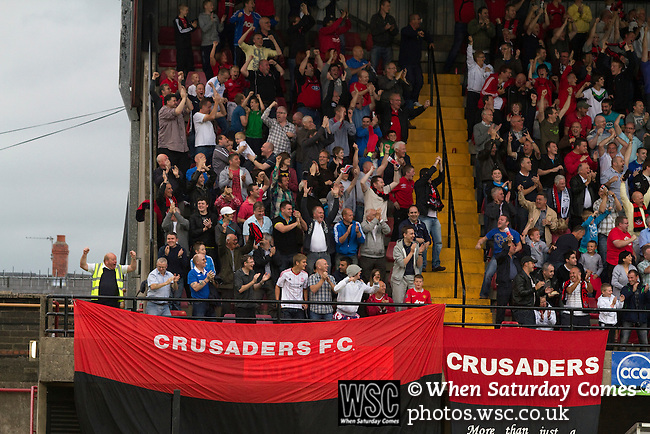 Crusaders 1 Fulham 3, 16/07/2011. Seaview Park, Europa League 2nd qualifying round first leg. Crusaders supporters celebrating their cteam's equalising goal at Seaview Park, Belfast as the Northern Irish club take on Fulham in a UEFA Europa League 2nd qualifying round, first leg match. The visitors from England won by 3 goals to 1 before a crowd of 3011. Photo by Colin McPherson.