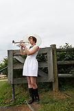 USA, Tennessee, Nashville, Iroquois Steeplechase, young woman bugler calls the start of the race