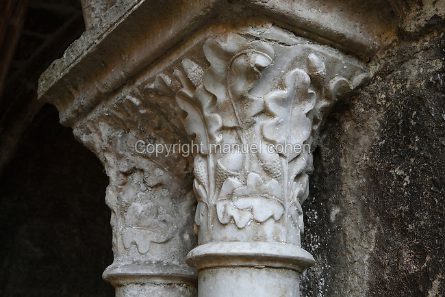 Capitals with foliage carvings of oak leaves and acorns from the Cloister of Fontfroide Abbey or l'Abbaye Sainte-Marie de Fontfroide, Narbonne, Languedoc-Roussillon, France. Founded by the Viscount of Narbonne in 1093, Fontfroide linked to the Cistercian order in 1145. These capitals date from the first cloister, built 1180-1210 in Romanesque style, with double columns topped by foliage capitals supporting semicircular arches. The cloister was later altered in the 13th century after the Albigensian Crusade, when tympanums were added and the original wooden roof was replaced with stone. Picture by Manuel Cohen