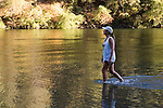 Woman cooling off in Lake Clementine on a hot summer day, Auburn California