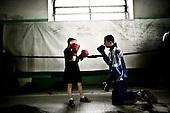Warsaw 04.2009 Poland<br /> Youngest boxer on Gwardia Warszawa, Konrad ( 9 age ) during training.<br /> Since the early 50' ties &quot;Gwardia&quot; has been famous for bringing up world boxing champions. The famed sports hall located by pl. Zelaznej Bramy in Warsaw witnessed trainings of Jerzy Kulej, the Skrzeczowie brothers, last Polish olympic champion Jerzy Rybicki or its most recent star Krzysztof &quot;Diablo&quot; Wlodarczyk. The club prides of numerous sport achievements, among others, 15 olympic medals (6 gold), over 60 medals from European and World Championships and over 100 from Championships of Poland.<br /> Today, only three small training halls remain from the former times of glory.<br /> One of the most famous in Polish history boxing section of Warsaw's &quot;Gwardia&quot; awaits its liquidation. This &quot;Mecca&quot; of Polish boxing is to be replaced by a huge supermarket,  decisions imposed by Warsaw authorities.<br /> ( Photo: Adam Lach / Napo Images )<br /> <br /> Najmlodszy bokser Gwardii Warszawa, Konrad ( 9 lat ) podczas treningu.<br /> Juz od wczesnych lat 50. Gwardia slynela z wychowywania swiatowych mistrzow bokserskich. W hali przy pl. Zelaznej Bramy trenowali Jerzy Kulej, bracia Skrzeczowie, ostatni polski mistrz olimpijski w boksie Jerzy Rybicki czy obecna gwiazda ringu Krzysztof &quot;Diablo&quot; Wlodarczyk. Klub moze poszczycic sie wieloma osiagnieciami sportowymi, do kt&oacute;rych przede wszystkim zaliczyc nalezy: 15 medali olimpijskich (w tym 6 zlotych), ponad 60 medali Mistrzostw Swiata i Europy i ponad 1000 medali Mistrzostw Polski. Teraz z dawnej swietnosci pozostaly zaledwie trzy male salki. Jedna z najslyniejszych w historii Polski sekcja bokserska Gwardii Warszawa ma byc zlikwidowana. Decyzja wladz Warszawy, te swego rodzaju mekke polskiego boksu ma zastapic wielki market<br /> (Fot Adam Lach / Napo Images )