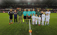 Children mascots with match officials and team captains Ashley Williams and Troy Deeney before the Barclays Premier League match between Swansea City and Watford at the Liberty Stadium, Swansea on January 18 2016