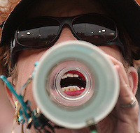 Jacksonville Jaguars fan Jane Moilanen yells encouraging words to the defense through her megaphone at Alltel Stadium in Jacksonville, Florida.
