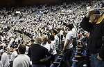 "Nevada fans show their support for quarterback Colin Kaepernick by ""Kaepernicking"" for 15-seconds during the NCAA men's basketball game between San Diego State and Nevada, on Wednesday, Jan. 23, 2013 in Reno, Nev. Kaepernick graduated from Nevada in 2011. (AP Photo/Cathleen Allison)"