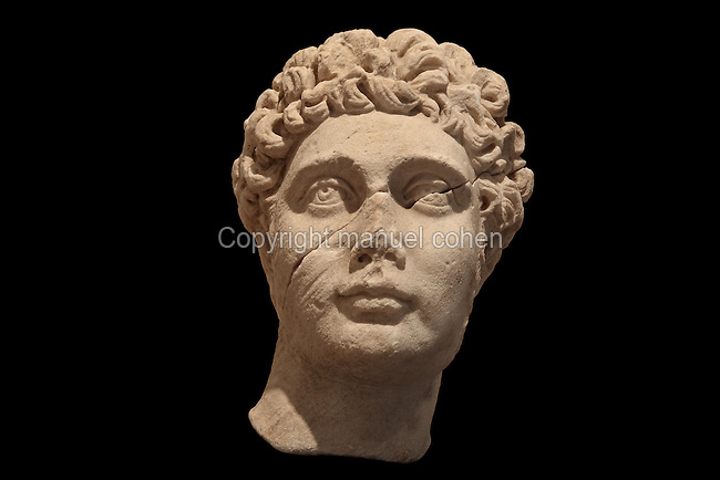 Sculpted head of a young man, Roman, from the Museum Of Apollonia near the Ardenica monastery in Fier, Albania. The museum was opened in 1958 to display artefacts found at the nearby Greek Illyrian archaeological site of Apollonia. Apollonia was an ancient Greek city in Illyria, founded in 588 BC by Greek colonists from Corfu and Corinth. It flourished in the Roman period and declined from the 3rd century AD when its harbour was silted up due to an earthquake. Picture by Manuel Cohen