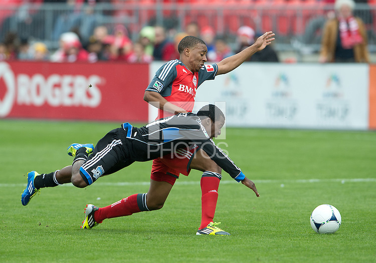 24 March 2012: Toronto FC midfielder Reggie Lambe #19 and San Jose Earthquakes midfielder Marvin Chavez #81 in action during the first half in a game between the San Jose Earthquakes and Toronto FC at BMO Field in Toronto..