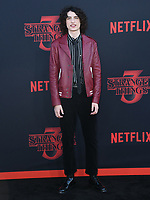 "28 June 2019 - Santa Monica, California - Finn Wolfhard. ""Stranger Things 3"" Los Angeles Premiere held at Santa Monica High School. Photo Credit: Birdie Thompson/AdMedia"
