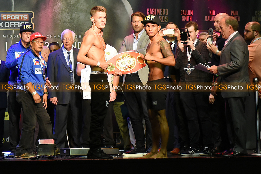 Boxers Charlie Edwards (L) and John Riel Casimero with the IBF World Flyweight Belt during a Weigh-In at the O2 Arena on 9th September 2016