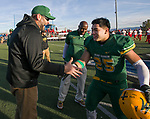 Bishop Manogue Miners  head coach Ernie Howren, left, congratulates Gilberto Aguilera (25) after their win over the Arbor View Aggies in the NIAA 4A State Semi-Final football game played at McQueen High School on Saturday, Nov. 24,2018.