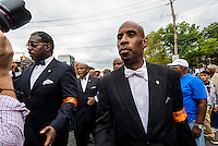 Staten Island, NY - Members of the Nation of Islam server as marshals as thousands marched through Stapleton, Staten IslandI to protest the killing of Eric Garner and call an end to police brutality.