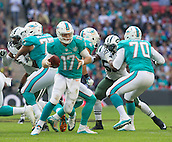 04.10.2015. Wembley Stadium, London, England. NFL International Series. Miami Dolphins versus New York Jets. Miami Dolphins Quarterback Ryan Tannehill runs with the ball.