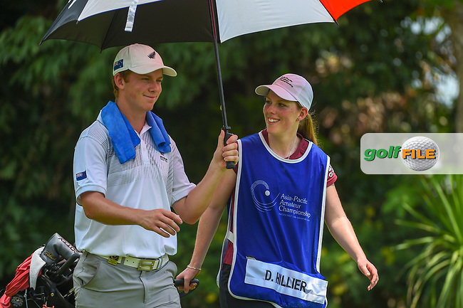 Daniel HILLIER (NZL) shares a laugh with his caddie as they head down 5 during Rd 2 of the Asia-Pacific Amateur Championship, Sentosa Golf Club, Singapore. 10/5/2018.<br /> Picture: Golffile | Ken Murray<br /> <br /> <br /> All photo usage must carry mandatory copyright credit (© Golffile | Ken Murray)