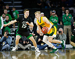SIOUX FALLS, SD - MARCH 10: Sam Griesel #5 of the North Dakota State Bison drives on Brady Danielson #15 of the North Dakota Fighting Hawks during the men's championship game at the 2020 Summit League Basketball Tournament in Sioux Falls, SD. (Photo by Richard Carlson/Inertia)