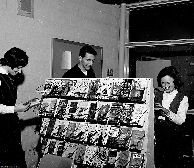 Bethel Park PA:  View of three students looking at the new paperbacks at the Bethel Park High School Library - 1964.  List of books included: Animal Farm, Agony and the Ecstasy, The Nun's Story, The Robe, The Call of the Wild, Anne Frank,, Tale of Two Cities, Gone with the Wind, Adventures of Sherlock Holmes, Kon-Tiki and the Legend of Sleepy Hollow