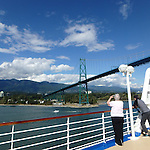 passenger takes photos from the deck of cruise ship leaving Vancouver, B C harbor