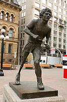 "Statue of Terry Fox in..Ottawa, Capital of Canada....In 1980, Terry Fox, who had lost a leg to cancer, began a coast-to-coast journey across Canada to raise money for cancer research. His ""Marathon of Hope"" ended with his collapse just outside of Thunder Bay, Ontario. He died less than a year later. The memory of his courage leads 500,000 Canadians each year to participate in the Terry Fox Run held to carry on Terry's quest for a cure for cancer....photo : (c)  Images Distribution.."