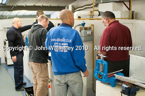 Student gas fitters with an instructor, Able Skills, Dartford, Kent.
