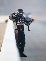 Oct 31, 2015; Las Vegas, NV, USA; NHRA funny car driver Brandon Welch after an engine fire during qualifying for the Toyota Nationals at The Strip at Las Vegas Motor Speedway. Mandatory Credit: Mark J. Rebilas-USA TODAY Sports