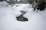 Camp 9 Brook in the Pemigewasset Wilderness of Lincoln, New Hampshire USA during the winter months.