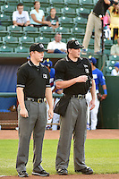 Base umpire Ryan Powers and Home plate umpire Aaron Higgins prior to the game against the Missoula Osprey and the Ogden Raptors on August 4, 2014 at Lindquist Field in Ogden, Utah. (Stephen Smith/Four Seam Images)
