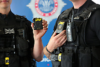 AXON bodycams held by firearms police officers. Wednesday 17 May 2017<br /> Re: Body worn video cameras are being introduced into the South Wales Police force as part of operational equipment and will be rolled out over the next few months.<br />  Forces across the UK are using this technology and integrating it into daily policing activities.  Body worn video may be used in court as evidence and for investigative purposes, including complaints against police or as a training material for police. <br />  Other forces have seen a range of benefits from using body worn video to support their general patrolling and investigative tasks. These benefits include:<br /> Gathering and presentation of evidence<br /> Changing the behaviour of offenders<br /> Lower incidence or escalation of violence<br /> Increased guilty pleas by defendants<br /> Increased time on patrol and less time spent on paperwork<br /> Improved public co-operation and interactions with police<br /> Improved transparency and accountability<br /> Professionalising police interaction<br /> Assistant Chief Constable Richard Lewis said: &ldquo;Equipping our officers with body worn cameras is the start of a new way we capture, utilise and share digital evidence.  The technology is very exciting and will assist officers and staff in doing their jobs, it will ensure that we are more accountable to the public that we serve and in turn build trust with our communities.