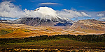 Mount Ngauruhoe stands magnificent in afternoon light as clouds encircle its snow capped summit..This New Zealand Fine Art Landscape Print, available in four sizes on either archival Hahnemuhle Fine Art Pearl paper or canvas, is printed using Epson K3 Ultrachrome inks and comes with a lifetime guarantee against fading..All prints are signed and numbered on the lower margin and come with my 100% money back guarantee on the purchase price, should you not be  completely happy with the quality of the delivered print or canvas.