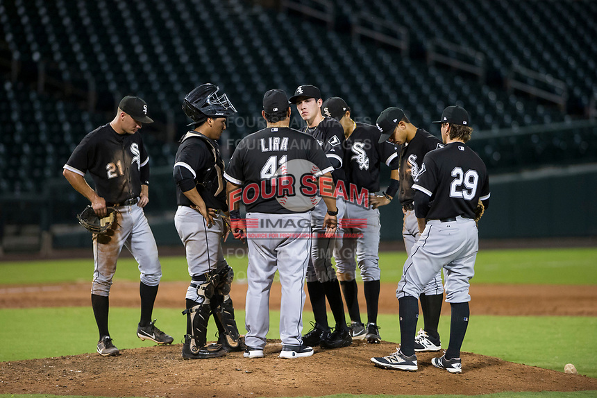 AZL White Sox pitching coach Felipe Lira (41) visits Salvador Villarreal (77) on the mound during the game against the AZL Cubs on August 13, 2017 at Sloan Park in Mesa, Arizona. AZL White Sox defeated the AZL Cubs 7-4. (Zachary Lucy/Four Seam Images)