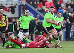 Scarlets lock Lewis Rawlins tackles Munster lock Billy Holland.<br /> Guiness Pro12<br /> Scarlets v Munster<br /> 21.02.15<br /> ©Steve Pope -SPORTINGWALES
