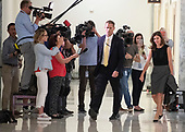 "Lisa Page, legal counsel to former FBI Director Andrew McCabe, right, departs past a large number of media following the first part of ""a transcribed interview"" before the United States House Judiciary Committee on Capitol Hill in Washington, DC on Friday, July 13, 2018. Page is considered to be a key witness by the committee for her role with Peter Strzok and decisions made by the Department of Justice and the FBI in the months before the 2016 Presidential election.<br /> Credit: Ron Sachs / CNP<br /> (RESTRICTION: NO New York or New Jersey Newspapers or newspapers within a 75 mile radius of New York City)"
