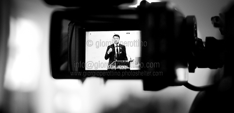 Italian Prime Minister Matteo Renzi is seen gesturing in a TV camera display during a meeting in Turin, September 17, 2014.