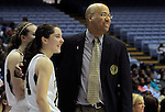 Bishop McGuinness' Erin Liebal, left, stands on the sidelines with head coach Brian Robinson during the Villains' 60-44 win, a 7th-consecutive state title and a new state record, at the Dean Smith Center in Chapel Hill, NC, on Saturday, March 10, 2012.  Photo by Ted Richardson