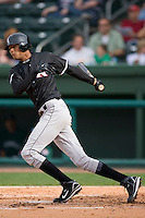 Jose Martinez (40) of the Kannapolis Intimidators follows through on his swing versus the Greenville Drive at Fluor Field in Greenville, SC, Sunday, April 6, 2008.