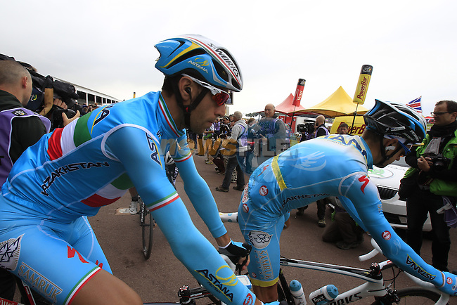 Vincenzo Nibali and Michele Scarponi (ITA) Astana at sign on at York Racecourse before the start of Stage 2 of the 2014 Tour de France running 200km from York to Sheffield. 6th July 2014.<br /> Picture: Eoin Clarke www.newsfile.ie
