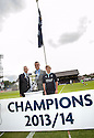 The 2013 / 2014 Championship Flag is raised at Dens Park.
