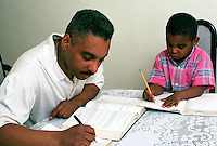 Pre-schooler plays pretend while father studies