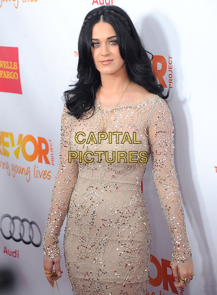 "Katy Perry.The Trevor Project's ""Trevor Live"" 2012 held at the Hollywood Palladium, Hollywood, California, USA..December 2nd, 2012.half length dress long sleeves beige white lace cream braid plait hair silver gold sequins sequined  .CAP/RKE/DVS.©DVS/RockinExposures/Capital Pictures."