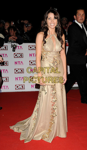 DANNII MINOGUE .The National Television Awards held at the Royal Albert Hall, London, England. October 29th, 2008.NTA red carpet arrivals full length gold dress long beige clutch bag.CAP/CAN.©Can Nguyen/Capital Pictures.