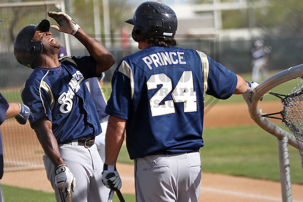 MARYVALE - March 2014: Greg Golson and Josh Prince of the Milwaukee Brewers during a spring training workout on March 18th, 2014 at Maryvale Baseball Park in Maryvale, Arizona.  (Photo Credit: Brad Krause)