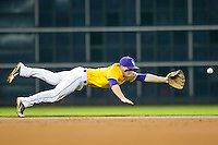 LSU Tigers shortstop Alex Bregman (8) dives for a ground ball during the Houston College Classic against the Nebraska Cornhuskers on March 8, 2015 at Minute Maid Park in Houston, Texas. LSU defeated Nebraska 4-2. (Andrew Woolley/Four Seam Images)
