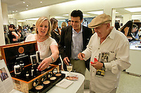 Woman picks out Menaji men's skincare product for male shopper at The Plaza Hotel's Fashion's Night Out event during New York Fashion Week, September 8, 2011.
