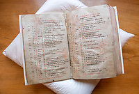 BNPS.co.uk (01202 558833)<br /> Pic: PhilYeomans/BNPS<br /> <br /> As well as the Psalms the book contains a list of the numerous feast days in the early church calender, decorated with the signs of the zodiac.<br /> <br /> Woman's touch - 1000 year old book from the Royal Anglo-Saxon Convent of Wilton is conserved.<br /> <br /> The ancient book was returned safely to Salisbury Cathedral after fears of a lockdown led to a hastily arranged emergency dash from the conservators in Cambridge.<br /> <br /> Dating from the 10th century the incredibly rare Psalter is fascinating to medieval scholars for two reasons - it is thought to have been used and adapted by women, and it's latin text has been annotated into early English to aid the understanding of the Anglo Saxon noviates who would have studied it.<br /> <br /> Prof Teresa Webber from Cambridge University notes  'The vast majority of surviving medieval monastic manuscripts survive from communities of monks or canons, but at some point early in its history this psalter was clearly adapted for use by a woman, only a handful of such manuscripts survive to this day'.<br /> <br /> This is likely to indicate the book was in use by the nuns of the Benedictine Convent at nearby Wilton expanded by Alfred the Great after a famous victory against the Viking invaders in 871.