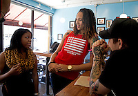 Jun. 10, 2013; Phoenix, AZ, USA: Phoenix Mercury center Brittney Griner (right) with her girlfriend inside the Golden Rule Tattoo shop in downtown Phoenix. Mandatory Credit: Mark J. Rebilas-