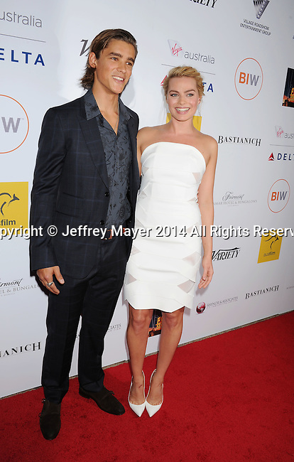 SANTA MONICA, CA- OCTOBER 26: Actors Brenton Thwaites (L) and Margot Robbie attend the 3rd Annual Australians in Film Awards Benefit Gala at the Fairmont Miramar Hotel on October 26, 2014 in Santa Monica, California.