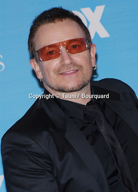 Bono ( U2)  at the 38th NAACP Awards 2007 at the Shrine Auditorium In Los Angeles.<br /> <br /> headshot<br /> orange Glass<br /> smile